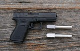 Glock - 23 - with three barrels .40 S&W .357 Sig and 9mm