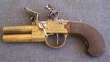British Flintlock over/ under BRASS double barrel pistol.