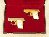 Cased Consecutive Pair of Colt 1908's, Gold Plated with Pearl Grips, Cal. .25 ACP - 1 of 19