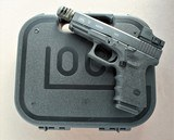 GLOCK MODEL 19 CUSTOMIZED WITH 4 MAGAZINES, RED DOT, EXTRA BARREL, MATCHING BOX AND PAPERWORK