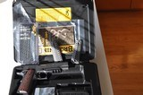 "Browning Black Label Pro w/rail, 4 1/4"" barrel, night sights w/extras"