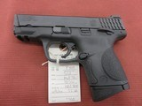 Smith & Wesson M&P 40c, 40 S&W - 1 of 2