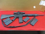 Remington R-25 .308 Win Rifle w/Bushnell scope, red dot, 5 spare mags