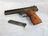 "1992 browning buckmark 22lr pistol, 5.5"" bull barrel, target sights, top pic rail, 2 mags, wood grips"