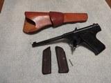 1926 colt pre woodsman pistol.22lr, original wood grips, set of black retro grips, era correct leather holster
