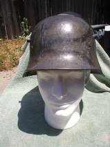 WW1 GERMAN M-17 CAMOUFLAGE STEEL HELMET, ORIGINAL LINER, SI 68 STAMPED, NAMED TO MULLER, 1 PILLOW IN PAD.