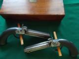 Harris Holland (originator of Holland & Holland) matched set of dualing Percussion Pistols
