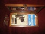 Colt 'Junior Colt Pocket' 25ACP Nickel-walnut display case, Sauer 'Snap Off' leather holster