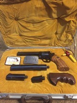 Dan Wesson special order package .357 Magnum Revolver with 4 barrels, 2 hardwood grips, Dan Wesson Belt Buckle and Dan Wesson Patch.