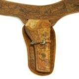 Denver tooled holster with Renalde gold/sterling buckle.