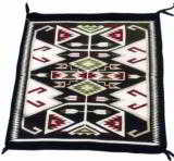 Crystal single saddle Navajo Rug with feathers and stylized waterbug