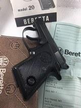 Beretta Rare model 20 Auto 25 cal. Pop-up Barrel 8+1 rounds factory rap-around grips 99% books & warrantee.
