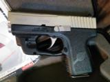 Kahr 9MM PM9 Semi-Auto Pistol with LaserMax sight.Like new with 3X magazines and original papers and receipts.