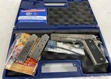 Colt 1911 .45 ACP Government Model brushed stainless - 1 of 8