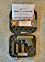 GLOCK 27 PISTOL 40 CAL 9 RD & 15 ROUND MAGS + HOLSTER