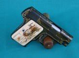 Custom Colt 1908 vest pocket .25 auto with gold inlay and mastodon grips