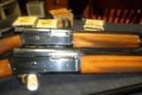 Two Belgium Magnum 20 GA