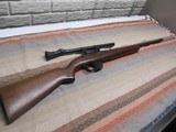 Winchester model 77 with period scope
