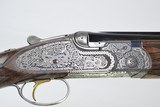 "CSMC- A10 - New Celtic engraved Platinum model 12 ga. 28"" barrels with screw in choke tubes"