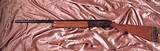 "Remington Model 1100 12 Ga Shotgun with 26"" Barrel, Vent Rib. and screw in chokes."