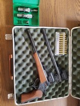 """G1 Thompson Contender pistol with two 14"""" barrels, case, optics, and reloading dies"""