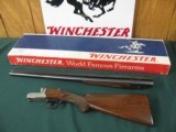 6512 Winchester 23 Pigeon XTR 20 gauge 26 inch barrels, ic/mod, vent rib,round knob, ejectors, butt plate,rose/scroll coin silver engraved receiver,NO