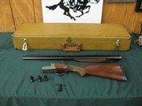 6571 Winchester 23 Pigeon XTR 20 gauge 26 inch barrels, 2 3/4 & 3 INCH CHAMBERS, 5 winchokes,s ic 2m full, wrench,round knob, Winchester butt pad, ALL