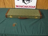 6575 Winchester CASE for 101 or 23 . will take 26 inch barrels, keys included, 98-99% condition. excellent condition.