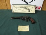 6005 Navy Arms 1875 Schofield 45 long colt 7 inch barrel case colored hammer and sight rear, walnut grips 99% AS NEW IN BOX WITH PAPER, APPEARS NEVER