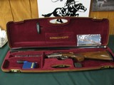 6608 Kreighoff K 80 Pro Sporter 12 gauge 32 inch barrels, adjustable comb and rib, lop 14 1/4,shot very little, tite, bores brite/shiny. comes with ca