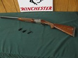 6611 Winchester 23 Pigeon XTR 20 gauge 26 inch barrels, 4 Briley chokes sk ic im f and wrench, 2 3/4 & 3 inch chambers, vent rib, single select trigge