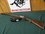 6610 Winchester 23 Pigeon XTR 12 gauge 28 inch barrels, 5 Briley chokes cyl, sk ic im f and wrench, 2 3/4 & 3 inch chambers, vent rib, single select t
