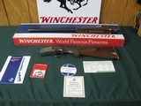 6634 Winchester 101 Pigeon XTR 12 gauge 26 barrels ic/mod round knob ejectors vent rib rose/scroll engraved coin silver receiver, Winchester butt plat - 1 of 13