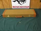 6643 Winchester 23 Golden Quail 12 gauge 26 inch barrels,ic/im raised solid rib, ejectors, STRAIGHT GRIP,single selective trigger, quail/dogs engraved