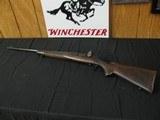 6671 Winchester model 70 22 hornet, 24 inch barrels, Redfield peep site, 2 side taps, steel butt plate,1938 mfg s/n1317x, bore brite/shiny