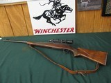 6672 Winchester model 70 300 H&H MAGNUM 26 inch barrel,steel butt. custom stock with cheek piece, leather sling Leupold 1.5 x 5 scope, excellent condi