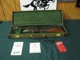 6716 Winchester 101 Quail Special 28 gauge 26 barrels sk ic mod Winchokes,pouch, keys, vent rib, quail,dogs engraved coin silver receiver, STRAIGHT GR - 1 of 12
