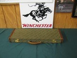 6731 Winchester 23 Classic 20 gauge 26 inch barrels ic/mod vent rib ejectors, single select trigger,pistol grip with cap, Winchester butt pad, ALL ORI