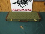 6750 Winchester 101 or 23 case will take 26 inch barrels,keys, leather trimmed.NEW OLD STOCK.