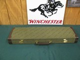 6769 Winchester 23 Pigeon XTR 20 gauge 26 inch barrels ic/mod, 2 3/4 & 3 inch chambers,vent rib, single select trigger, ejectors, rose/scroll coin sil