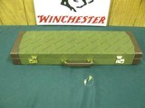 6792 Winchester 101 or 23 case, NEW OLD STOCK WITH KEYS, NEVER A GUN IN IT. will take 26 inch barrels.