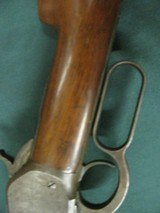 6797 Winchester 1886 45-70 26 inch barrel,blade front site, semi buckhorn elevator rear site, lever action, metal butt plate,all original, bore is ave - 7 of 18