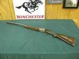 6819 Winchester 23 Pigeon XTR 20 gauge 26 inch barrels, winchokes screw in skeet and mod. TIGER STRIPED WALNUT AA++, vent rib, ejectors, 3 inch chambe