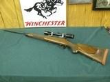 6990 Winchester model 70 SUPERGRADE 338winmag,26 inch barrel, 1984 Mfg,CLAW EXTRACTOR,AA+Fancy figured walnut. Winchester pad, all original 99% condit