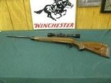 6997 Remington BDL Custom Deluxe 300 win mag 24 inch barrel, ebony tip, 3x9 Burris,duplex reticle,skip line checkering,Remington butt pad, bore brite/