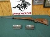 7038 Winchester Model 70 264 Win Mag 26 inch barrel,custom Timiney trigger, rose wood cap, ebony forend tip, decelerator pad 13 1/2 lop,Talley bases,