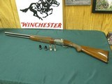 7093 Winchester 23 Pigeon XTR 12 gauge 26 inch barrels,4 screw chokes ic mod full xfull,vent rib, ejectors, round knob, all original, Winchester pad
