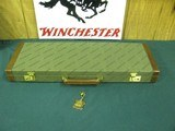 7115 Winchester 23 or 101 or other gun. the case will take 26 inch barrels, has the keys, NEW OLD STOCK, leather trim.