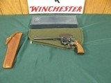 7102 Smith Wesson 48-4 barrel 8 3/8 22 MAG, square K frame ,narrow serrated combat trigger patridge front MCS rear,Magna checkered walnut medallion gr