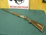 7169 Winchester 101 Pigeon 12 gauge 28 inch barrels mod and full fixed choked, early one with very dark walnut and diamond tipped tool engraving. orig